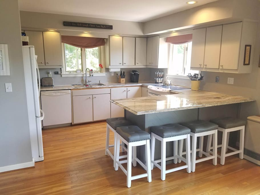 Enjoy the new quartzite stone countertop in the freshly-painted, fully-stocked kitchen.  (outside gas grill also included)