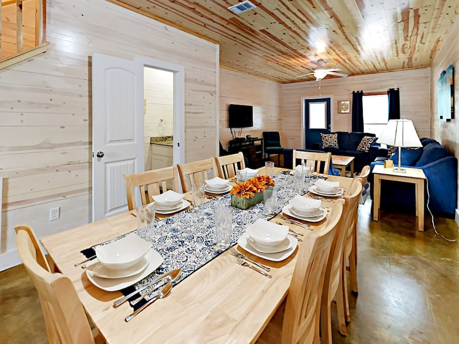 Gather the group around the dining room table with seating for 8.