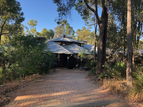 Our beautiful house, nestled amongst the trees. The granny flat is to the right.
