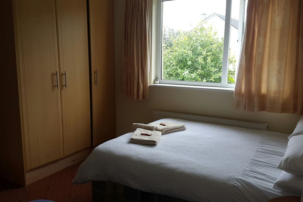 Cosy private en suite bedroom with a double bed and a single bed