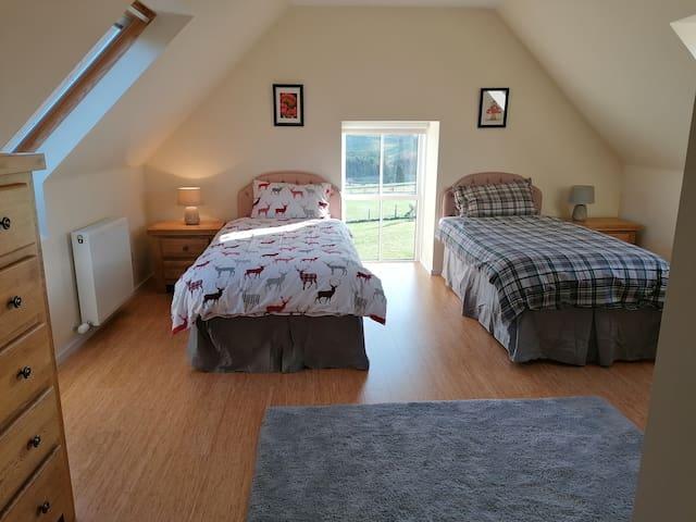 Bedroom 3, twin beds and en suite shower room