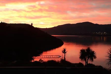 Rapaki Retreat - Sunrise by the Sea.