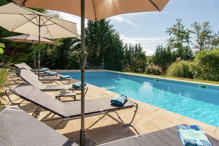 Spacious villa with heated pool, several terraces and a lot of privacy.