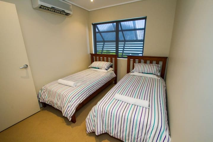 Twin single beds in third bedroom- Airconditioned