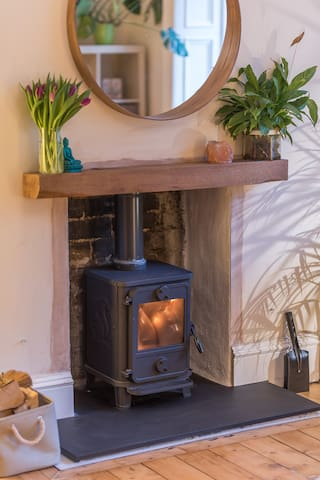 Newly installed Squirrel wood burning stove.  Oak wooden mantle and circular mirror.