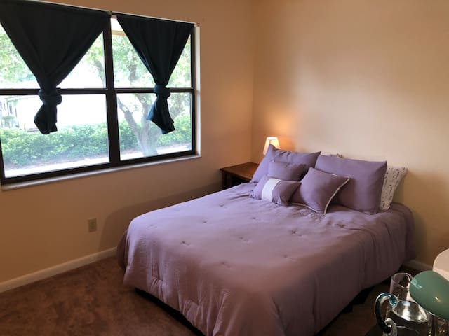 Room has comfortable bedding, bedside lamp, a small desk, chair and hangers in the closet. If you want to have a relaxing wake up, the blackout curtains will keep the sun out!
