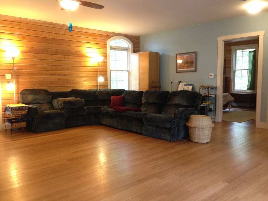 This is the seating area in the main room.  Couch faces the Entertainment Center.  Open door is to bedroom #1.
