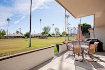 Patio on golf course side of condo with mountain views and morning sun