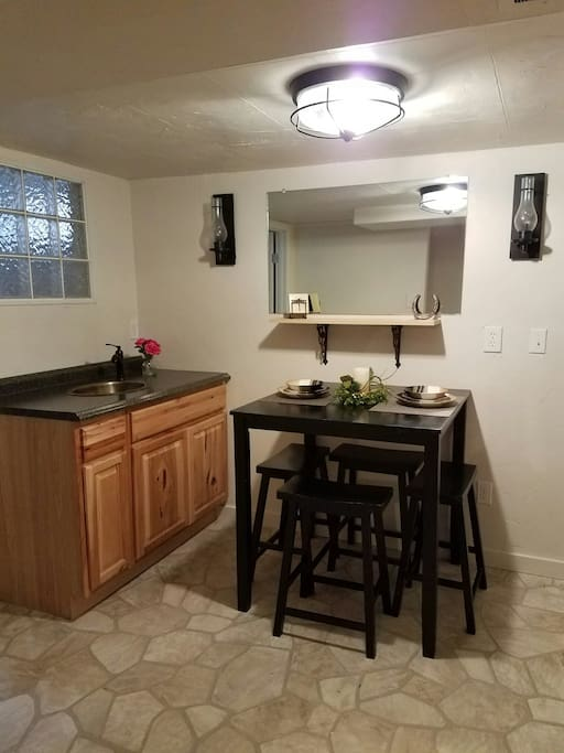 Kitchen with stove, microwave and refrigerator. Washer and dryer are available in the room adjacent to the kitchen.