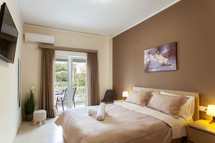 """Theotokopoulos park apartment - bedroom - one double bed, 43"""" TV with Netflix and view from the balcony"""