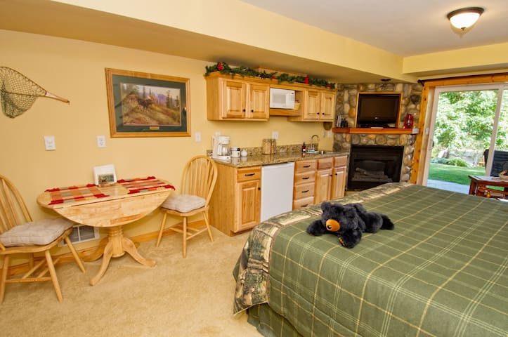 The Alpine Suite with river rock gas fireplace, kitchenette fully stocked with dishes, silverware, wine opener, fridge, microwave, breakfast in your room, and table for 2.