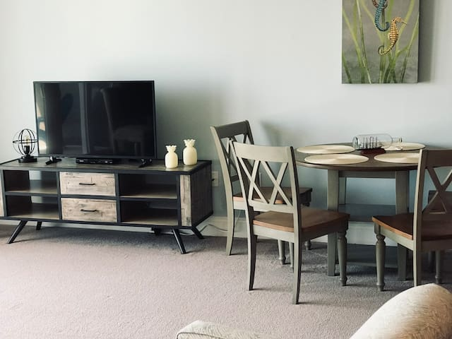 Family room TV, drawer space, and dining