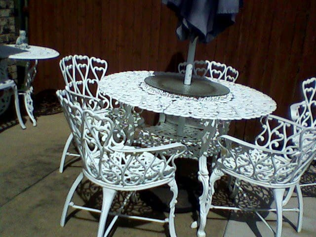Patio furniture inside a 6 ft. wooden fence backyard.
