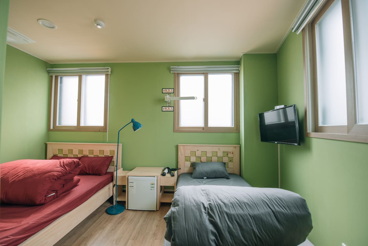 one hinoki wooden double bed and one single bed with latex mattress