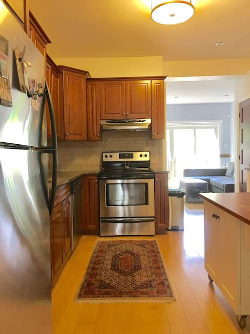 Eat-in kitchen with new stainless steel appliances