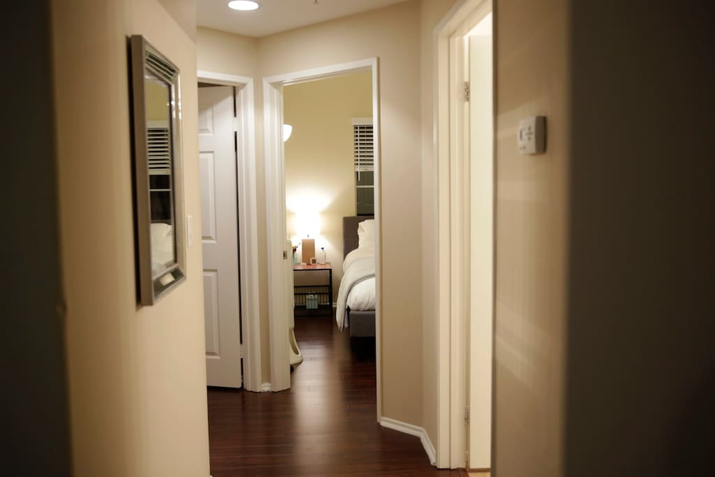 Hallway leading down to your room. Door to the right is your bathroom. Thermostat in hall controls Central AC / Heat & you have equal access to adjust to your comfort.
