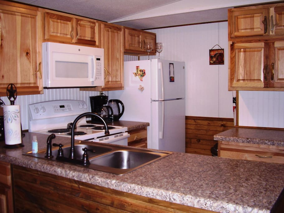 Completely renovated kitchen with 2015 appliances, Texas pine cabinetry with antler hardware.  Includes dishwasher.