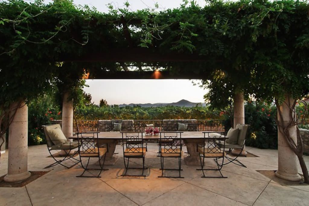 Outdoor dining with views of the vineyard and El Toro