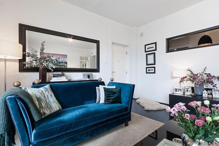 Beautiful hues and fabrics use throughout the apartment