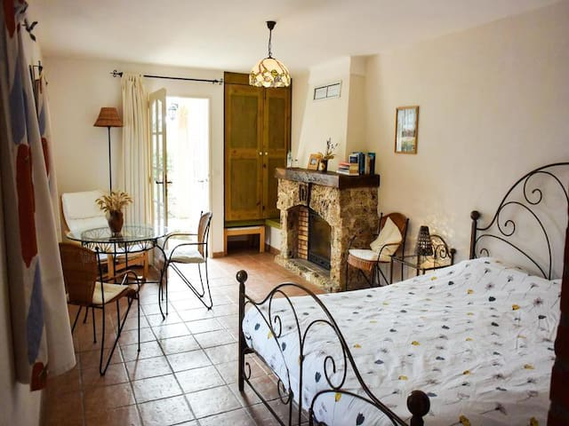 Room 1 - Cassini: Light, bright, and stylish double room with a feature fireplace With an en-suite shower, and a separate toile. It is located on the ground floor with its own entrance and direct access to the garden and patio dining area.