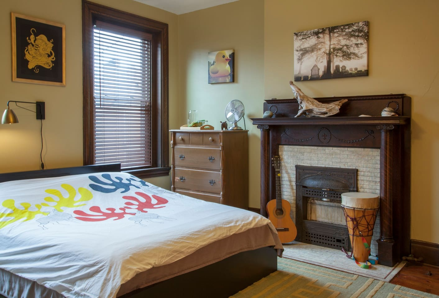 Guest bedroom with local art, recommendations, and the comforts of home
