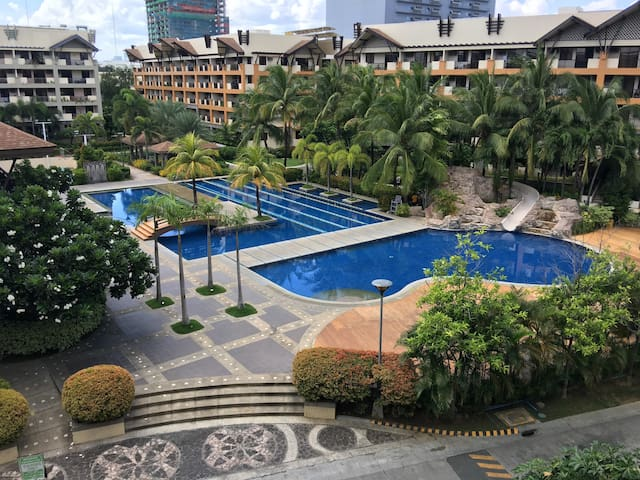 Mega poolside with three merging pools, sun deck and children's water slide...