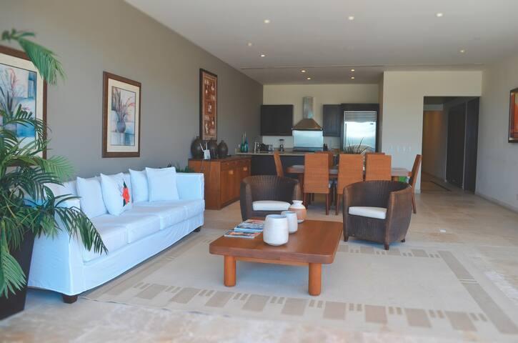 Elegant condo, beach front , common pools, views