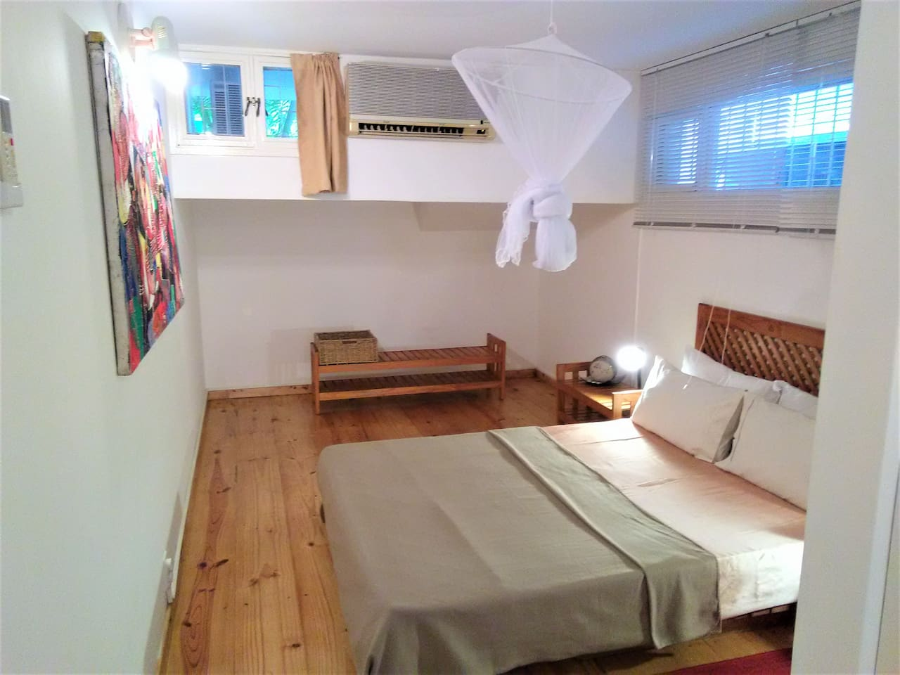 Bedroom with a Japanese bed and a good soft mattress, air conditioner and mosquito net