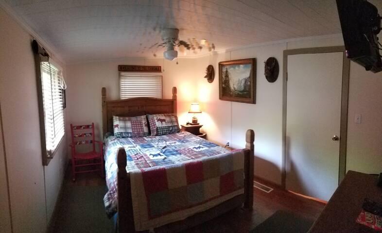 "Queen bed, larger,dresser, 32"" Roku TV, shared master bath,ceiling fan, nightstand usb charging station."