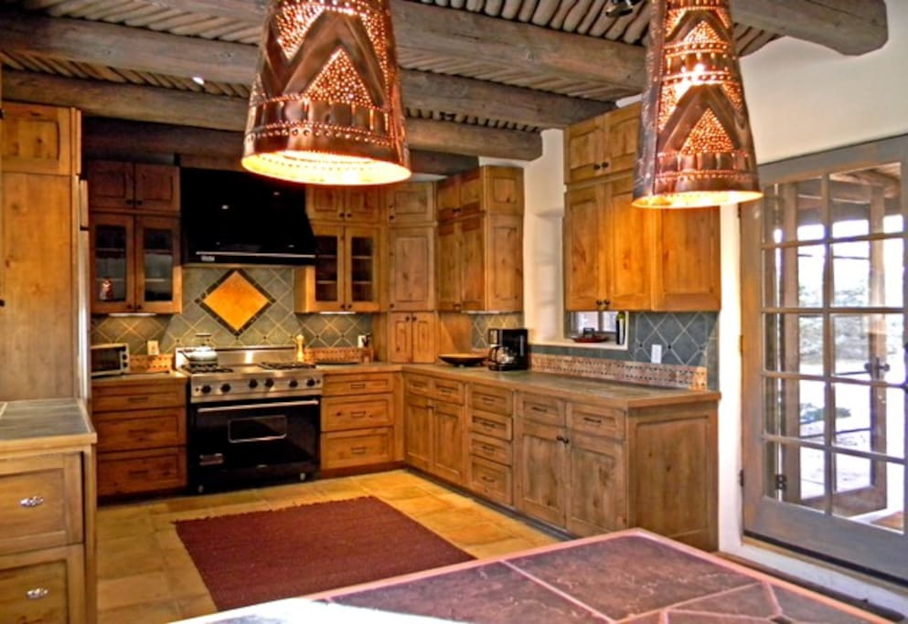 Elegant, upscale gourmet kitchen including commercial Wolf gas oven/range