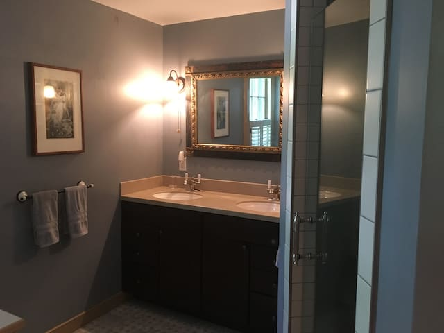 Large suite bathroom has double sinks for plenty of space in the bathroom.