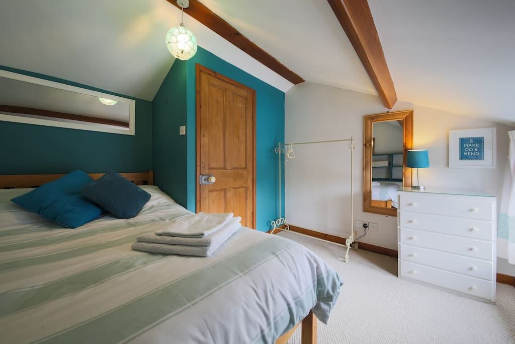 Cosy bedroom with chest of draws, hanging rail and 4ft double bed.