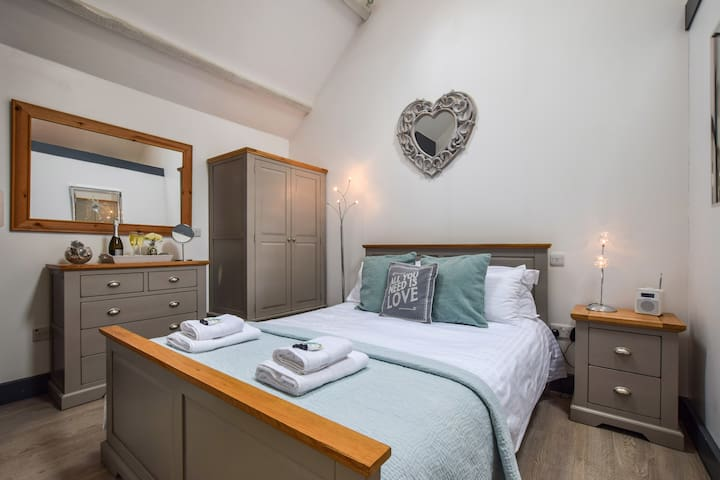 The king-size bedroom showing wardrobe, chest of drawers and bedside chest
