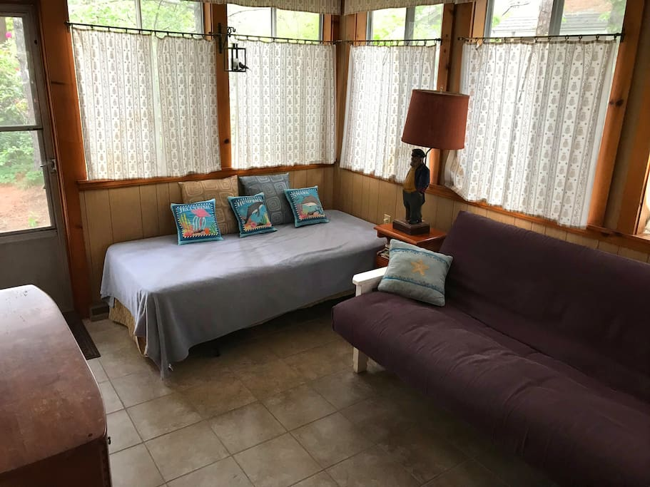 Back porch with twin bed and double futon