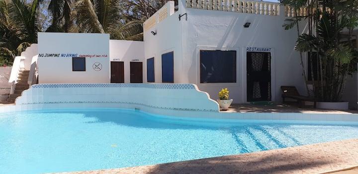 Kivuli villas we charge per room per night basis .