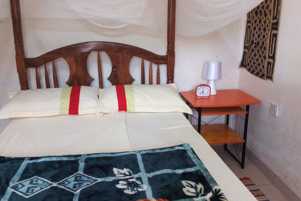 Our cozy double bed room with mosquito net