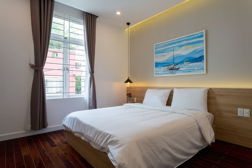 Your room with natural light, queen size bed, wardrobe, private fridge, private bathroom , clean beddings and towels