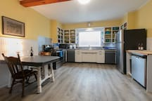 Huge country kitchen with all new appliances, dishes and cookware and a dishwasher to make clean up easy