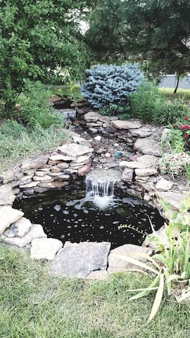 The waterfall and fish pond belong to my neighbor but we all enjoy it!  7 fish live in the pond and appreciate any worms.!  It is truly colorful!  Wider and deeper than you think.  All 7 fish survived both blizzards this winter