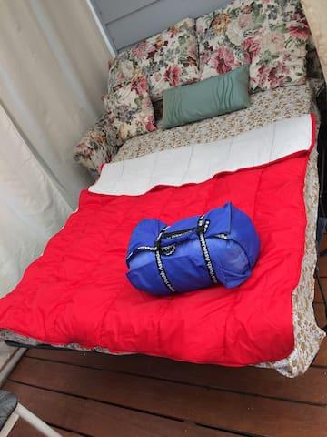 "real bed - nice & big ""deck"" under covered-bayside"