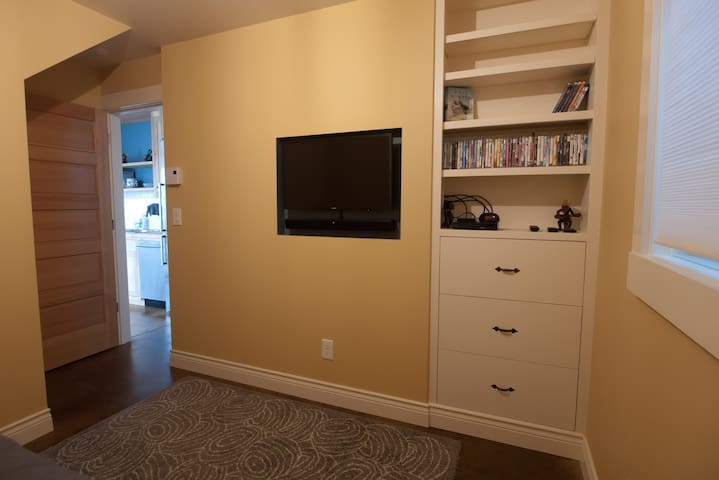Downstairs bedroom has built-in TV w/ Apple TV & BluRay player, w/ a collection of movies.  Receives some network stations via antenna (no cable).
