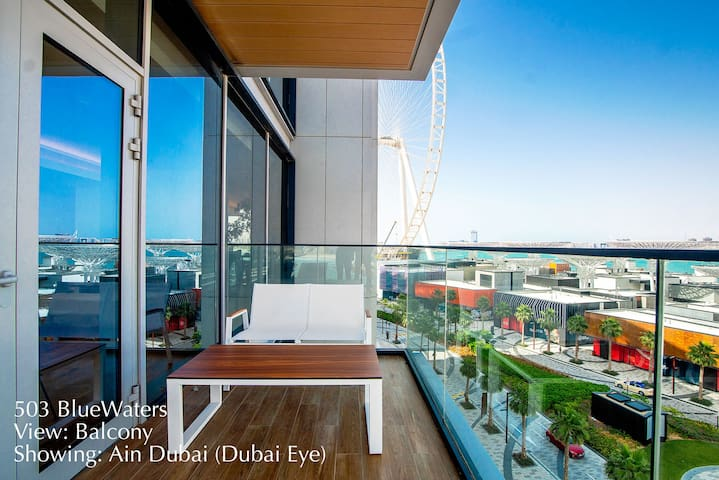 Another view of the L-shaped balcony showing outdoor furniture and Ain Dubai on Bluewaters Island.