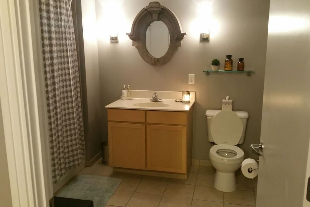 Spacious ADA accessible bathroom with full tub
