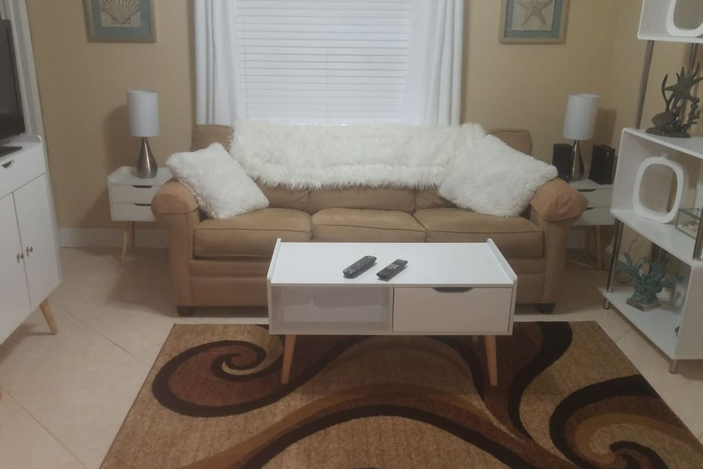 Super clean, light, white and bright Chic and upscale , all new mid century furniture. Great  look and feel. Very relaxing. Couch very comfortable and pulls out into a king size bed. Even have an extra gel overlay mattress for maximum comfort.
