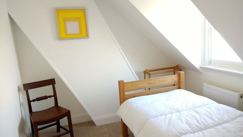 This is one of two bedrooms on the top floor, a comfortable single.