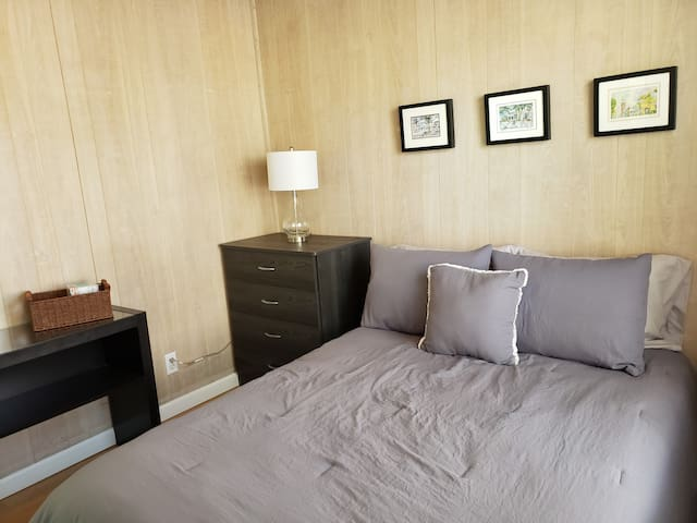 """The """"Grey Room"""" - Queen size platform bed with new, 10"""" hybrid (spring coil/memory foam/gel) mattress. Extra pillows and blankets provided."""