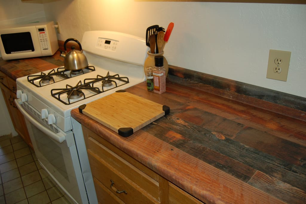 The new custom counter tops have faux recycled wood, reflecting the many kinds of woods we put in the cabin