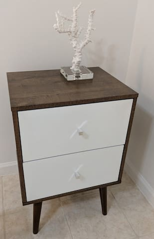 Bed side table with draws, good for long term stays to put cloths and personal items.