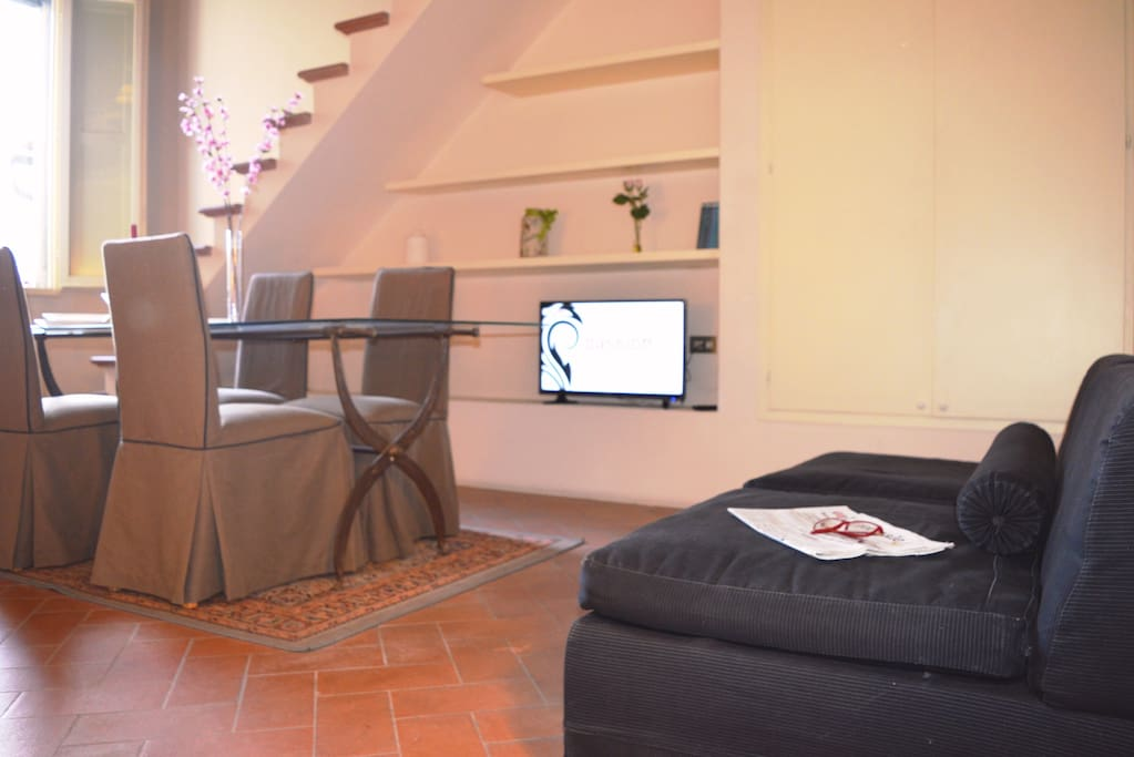 living room with sofa double bed, table for 6 people and TV
