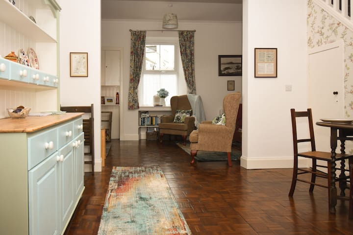 View from kitchen door through to front of cottage